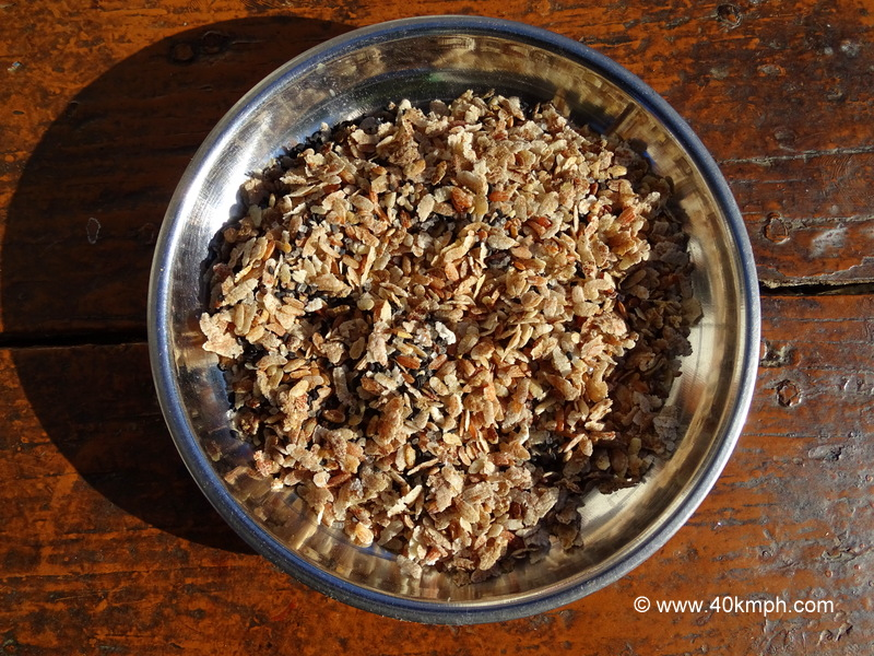 Flattened Rice (Chiwda) mixed with Black Seasame Seeds and Sugar
